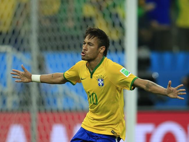 Brazilian forward Neymar celebrates scoring during game one of the 2014 FIFA World Cup. Picture: AFP/Adrian Dennis