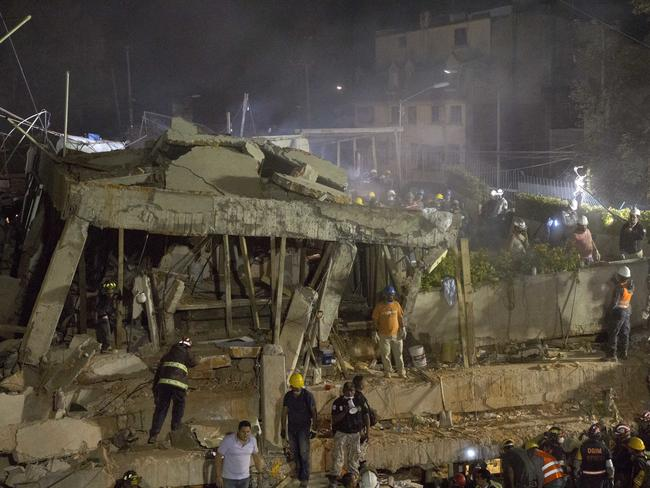 Volunteers and rescue workers search for children trapped inside at the collapsed Enrique Rebsamen school in Mexico City. Picture: AP