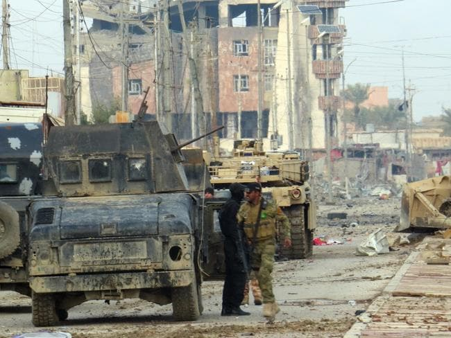 Fighting back ... Iraqi pro-government forces battle Islamic State (IS) group jihadists as they try to secure all the neighbourhoods of Ramadi. Picture: AFP