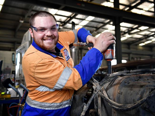 Heavy vehicle diesel technician Aiden Bird works on a truck at CMV Truck Sales and Service. Picture: Bianca De Marchi