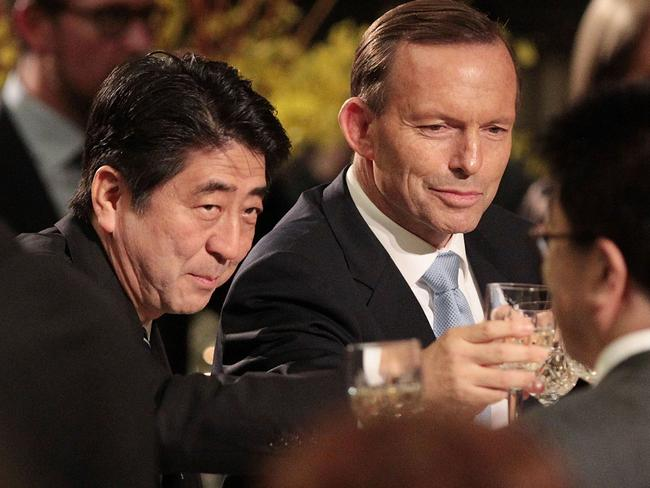 The carbon tax wasn't abolished today, but Mr Abbott got the opportunity to chum it up with Japan's Prime Minister Shinzo Abe. Picture: Getty Images