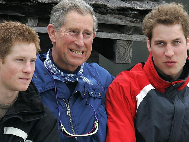MARCH 31, 2005: Britain's Prince of Wales, Charles (C), with his sons Harry (L) and William (R) during a media photocall, in Monbiel near the Swiss resort of Klosters, 31/03/05, where they are on their annual skiing holiday. Royals / Family Picture: Ap