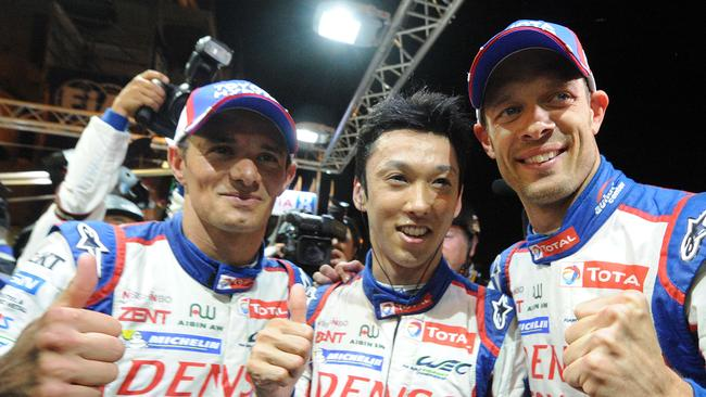 Japanese driver Kazuki Nakajima is congratulated by his teammates Stephane Sarrazin and Alexander Wurz after scoring pole position for the Le Mans 24-hour race.