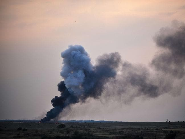 Fighting continues ... Smoke billows from a Ukrainian fighter jet crash site near the village of Zhdanivka, Ukraine.