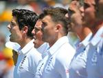 England captain Alastair Cook (L) sings the national anthem.
