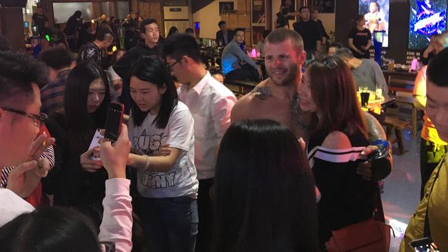 Geelong MMA star Peter Davenport mobbed by Chinese fans.