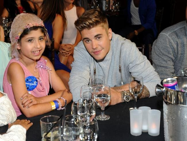 Pretty in pink ... Justin Bieber (right) with his tiny Awards date Grace Kesablak. Picture: Angela Weiss