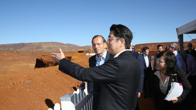 Looking at the mine ... Prime Minister Tony Abbott and the Japanese Prime Minister Shinzo Abe at Rio Tinto's West Angelas iron ore mine in the Pilbara, Western Australia. Picture: Gary Ramage