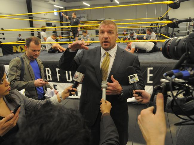 Paul Levesque talks to reporters at the WWE Performance Center in Orlando.