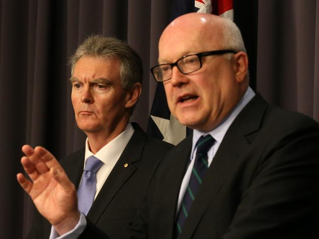 Attorney-General George Brandis and the new Director General of ASIO, Duncan Lewis, address the media in Canberra.