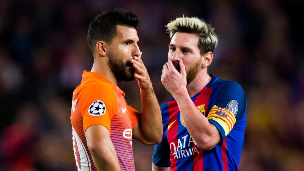 Sergio Aguero (L) of Manchester City FC speaks with Lionel Messi (R) of FC Barcelona.