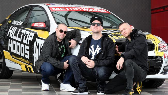 BACK AGAIN: The Hilltop Hoods, DJ Debris, MC Suffa and MC Pressure who are playing the Clipsal after race concert next year, with the Clipsal 500 Course Car. Picture: Calum Robertson
