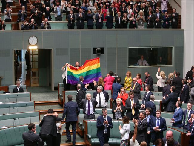 Celebrations after the Marriage Amendment (Definition and Religious Freedoms) Bill 2017 passes in the House of Representatives Chamber, at Parliament House in Canberra.