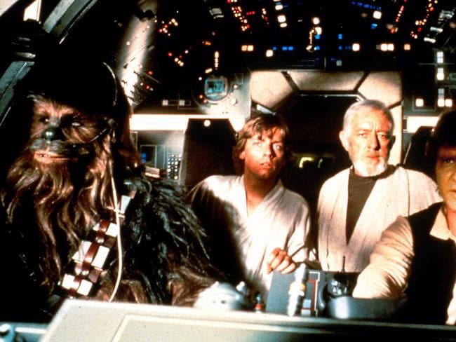 Space ship ... (L-r) Chewbacca character with actor Mark Hamill, Alec Guinness and Harrison Ford in the Millennium Falcon.