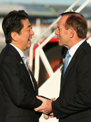 Don't mention the war ... Japanese Prime Minister Shinzo Abe is farewelled by Australian Prime Minister Tony Abbott. Picture: Paul Kane