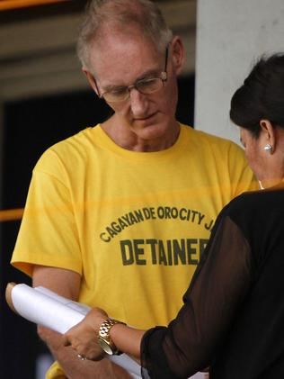 Gerard Peter Scully arrives at a court for his arraignment on rape and torture charges. Picture: AFP