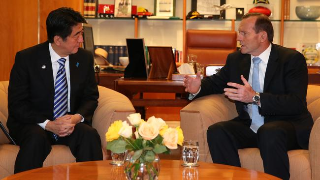 Getting down to business ... Japan Prime Minister Shinzo Abe meeting with Prime Minister Tony Abbott in his office at Parliament House in Canberra. Picture: Kym Smith
