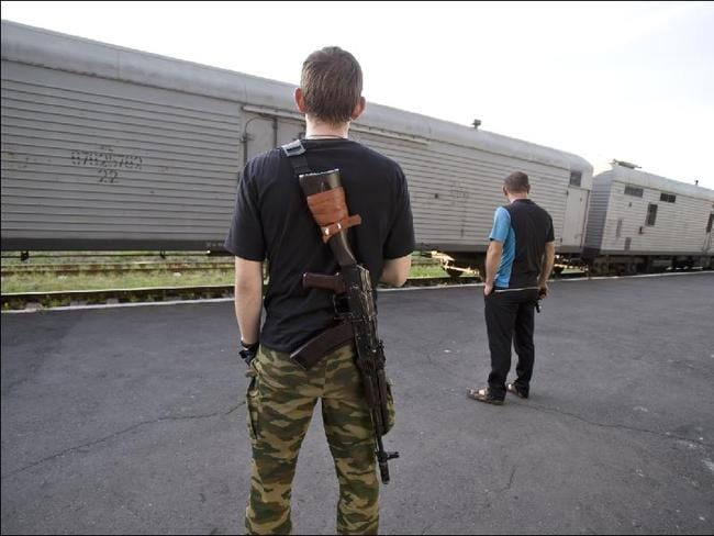 On guard ... The refrigerated rail cars being used to preserve the dead recovered from the MH17 crash site.