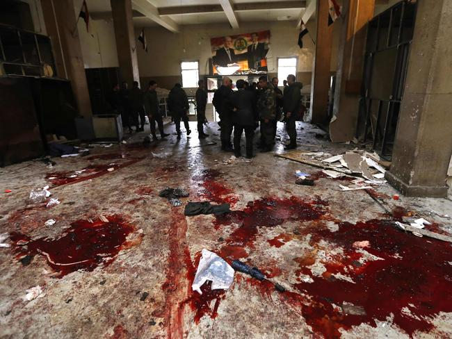 Two suicide bombings hit Damascus, including an attack at the central courthouse that left dozens dead. Picture: AFP/Louai Beshara
