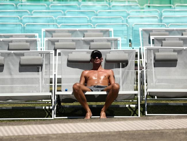 A shirtless spectator enjoys the hot weather on day four of the 2018 Australian Open at Melbourne Park yesterday. Picture: Ryan Pierse/Getty Images