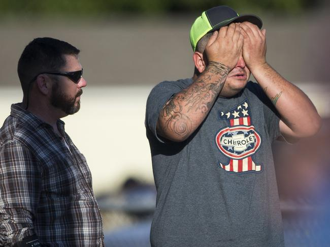 A man wipes his eyes after a deadly shooting at the First Baptist Church in Sutherland Springs, Texas. Picture: AP