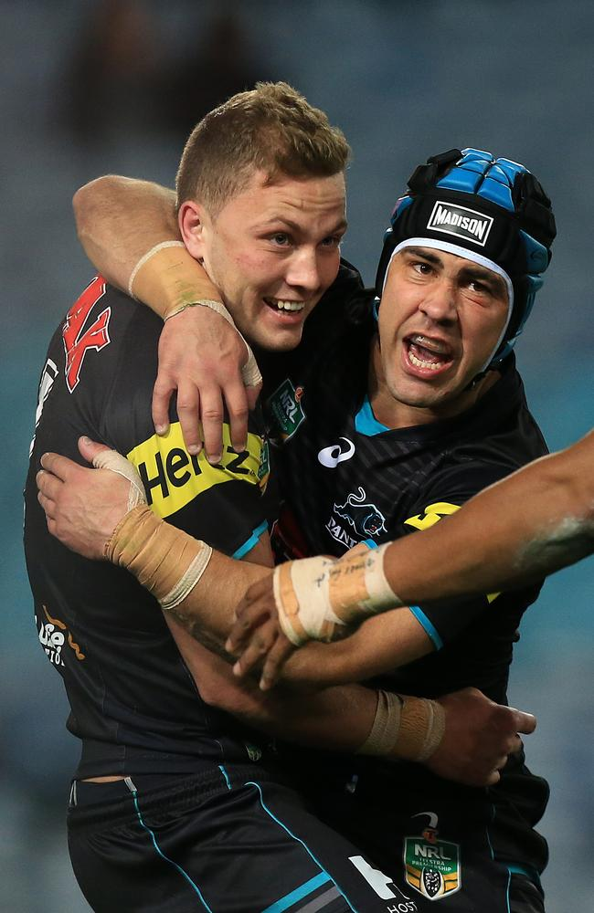 Matt Moylan celebrates his try with Jamie Soward.