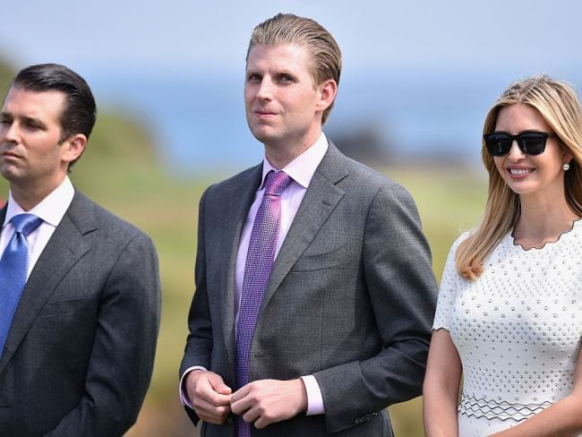 Donald Trump Junior, Eric Trump and Ivanka Trump listen to their father at a Trump Organisation golf course event in Scotland. Photo: Jeff J Mitchell/Getty Images