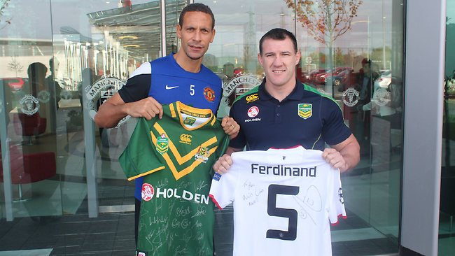 Kangaroos vice-captain Paul Gallen swaps jerseys with Manchester United defender Rio Ferdinand. Picture: NRL