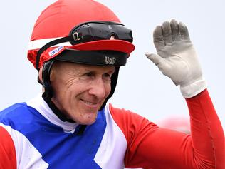Jockey Jeff Lloyd waves after riding Cantbuybetter to win race 3 during the Doomben 10,000 race day at Doomben racecourse in Brisbane, Saturday, May 13, 2017. (AAP Image/Dan Peled) NO ARCHIVING, EDITORIAL USE ONLY