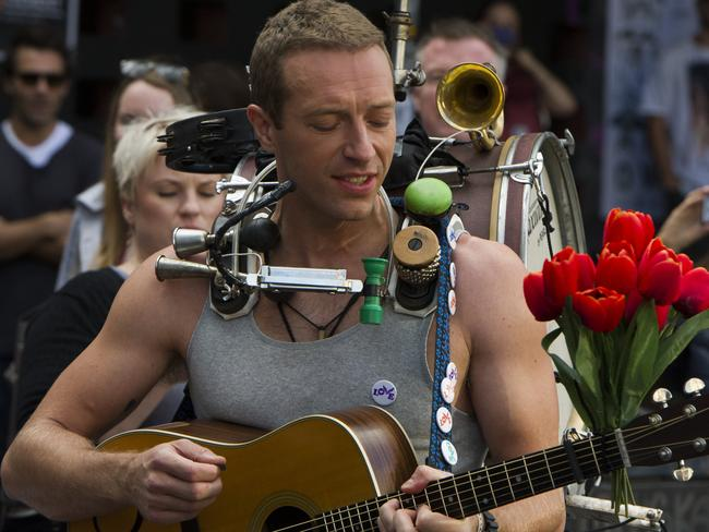 Chris Martin walks down Newtown's King St while making the music video. Picture: Chris McKeen