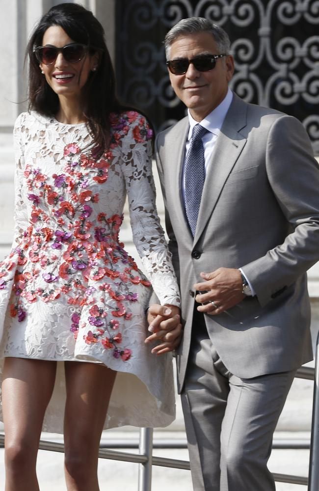 Glamour couple ... Amal Alamuddin rocks another fab frock after her wedding in Venice. Picture: AP