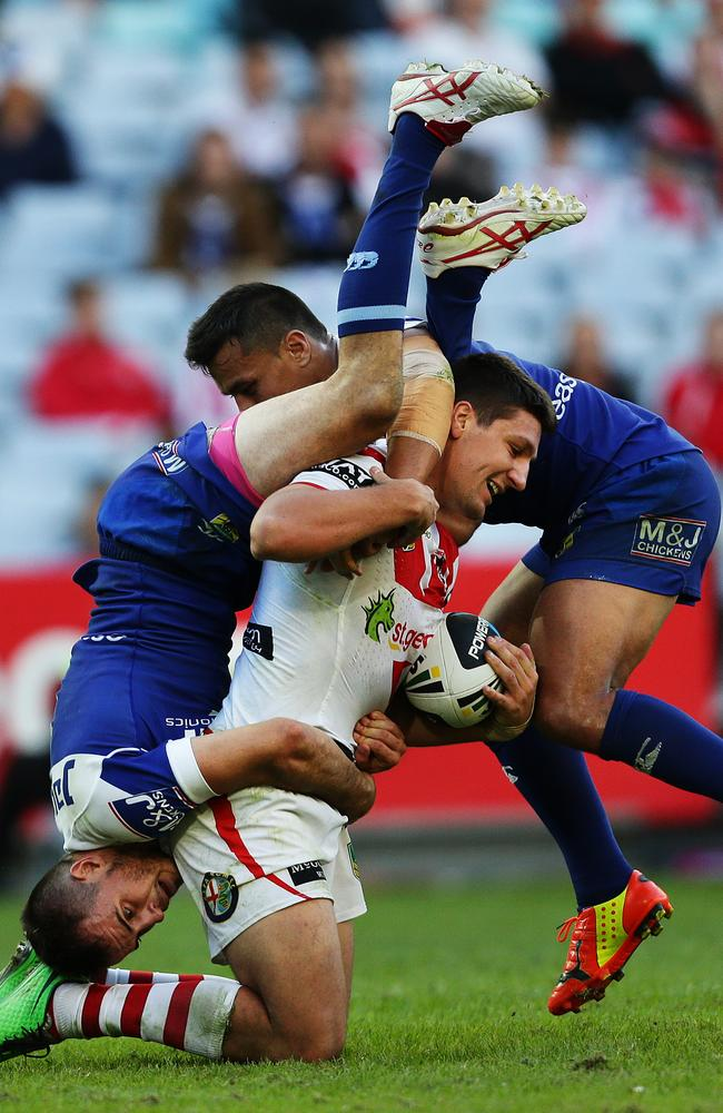 Josh Reynolds also got it wrong in this tackle on Gareth Widdop. Pic Brett Costello