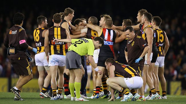 Essendon v Hawthorn at Etihad Stadium.,July 26th., Hawthorn's Jarryd Roughead on the ground after colliding with Essendon's Jake Melksham off the ball in the third quarter. Picture: Klein Michael