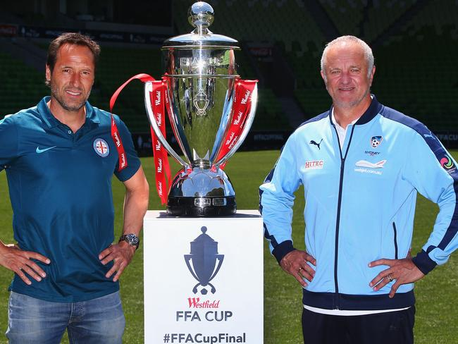 Melbourne City coach John van't Schip and Sydney FC coach Graham Arnold with the FFA Cup trophy at AAMI Park. Picture: David Caird