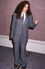 Julia Roberts ditched the classic red carpet look for a baggy and very daggy looking grey business suit in 1990. Picture: Ron Galella, Ltd./WireImage