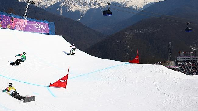 Torah Bright (yellow) is left behind by Belle Brockhoff (green) after she crashed in the quarterfinals of the women's slopestyle.