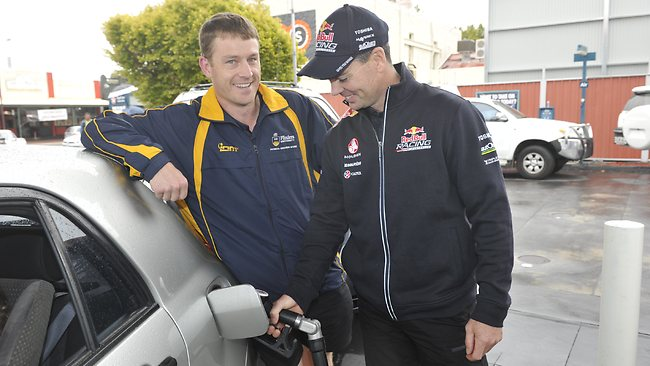 Craig Lowndes pumps the fuel for Mark Sansome of Aberfoyle Park during the promotion. Picture: Campbell Brodie