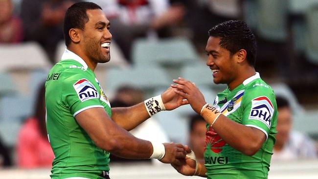 Bill Tupou and Anthony Milford celebrate another try.