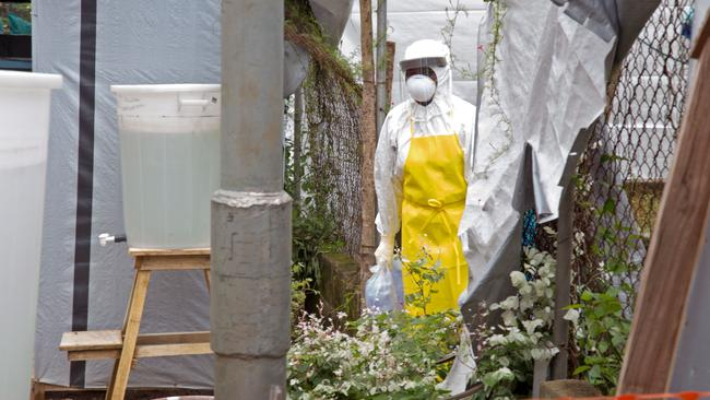 A healthcare worker near an Ebola isolation unit wears protective gear against the virus at Kenema Government Hospital in Kenema, Sierra Leone.