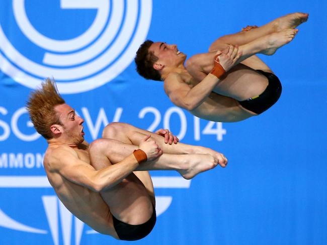 Matthew Mitcham and Dominic Bedggood of Australia on their way to gold in the men's synchronised 10m platform.