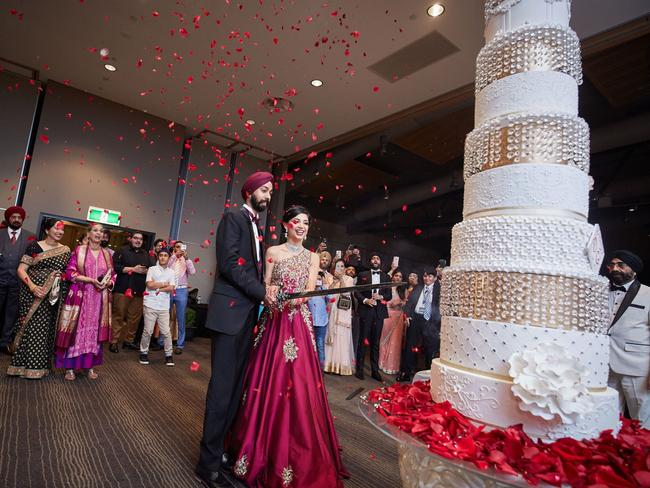 The towering 10-tier cake was cut by a sword. Picture: Southern Light Photography