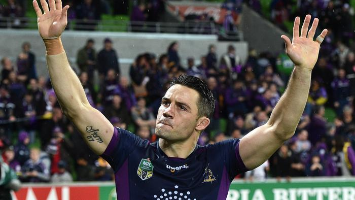 Cooper Cronk is seen after playing his 300th game in the NRL preliminary final between the Melbourne Storm and the Canberra Raiders at AAMI Park in Melbourne, Saturday, Sept. 24, 2016. (AAP Image/Julian Smith) NO ARCHIVING, EDITORIAL USE ONLY