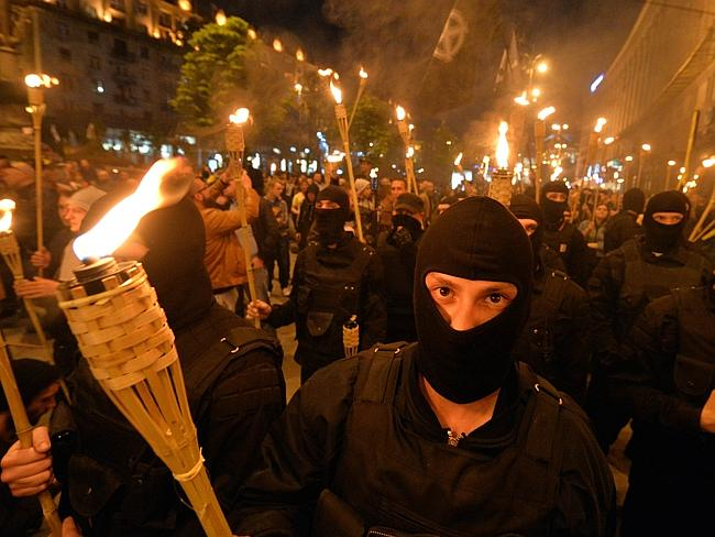 """Bracing for action ... Unknown ultranationalists activists march towards the Independence Square to commemorate """"Maidan heroes"""" in Kiev."""