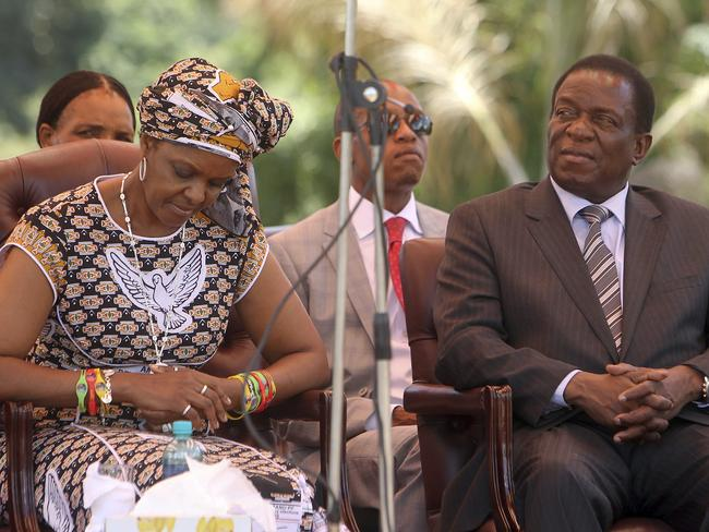 Zimbabwean first lady Grace Mugabe, left, sits next to vice President Emmerson Mnangagwa. A succession struggle between the two appears to be behind the coup. Picture: AP