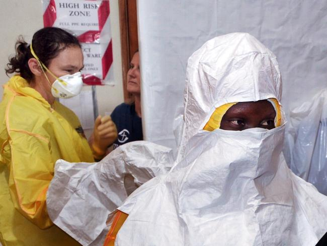 Taking precautions ... Staff of the Christian charity Samaritan's Purse putting on protective gear in the ELWA hospital in the Liberian capital Monrovia. Pic: ZOOM DOSSO