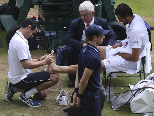 Marin Cilic has treatment on his foot as he takes a medical time-out.