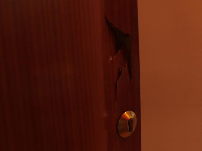A broken door lies open after a police raid on the house of the Oukabir family. Picture: AP