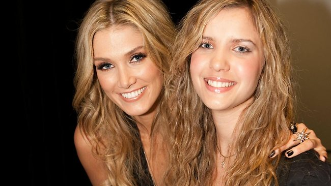 Vision-impaired singer Rachael Leahcar pictured on The Voice with singer Delta Goodrem.