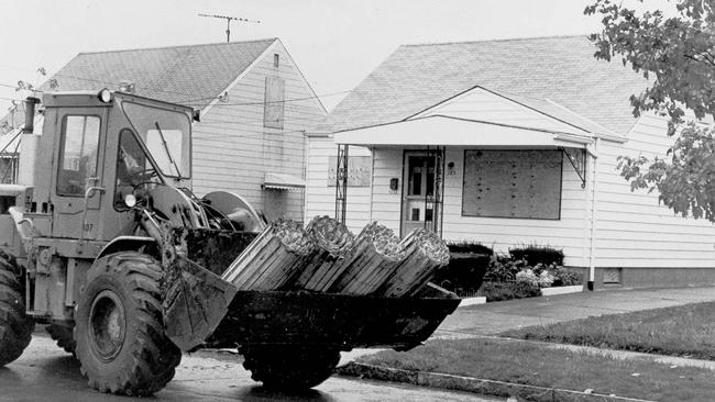 Heavy equipment rumbles through the deserted streets of the Love Canal neighbourhood of Niagara Falls, in 1978, in preparation to demolish the houses. Picture: AP Photo/TK.