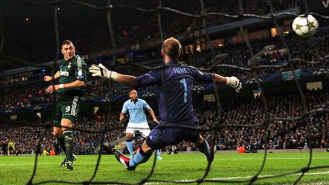 Karim Benzema of Real Madrid scores the opening goal past Joe Hart of Manchester City in the UEFA Champions League Group D match at the Etihad Stadium. Picture: Shaun Botterill